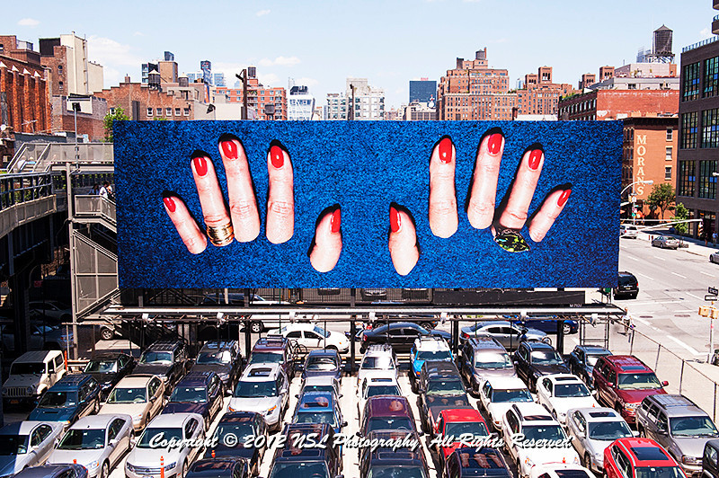 The High Line billboard at 18th Street and the High Line by artist Maurizio Cattelan, and photographer Pierpaolo Ferrari, photographed in Milan