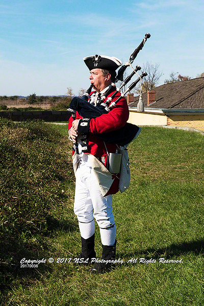 Redcoat playing the pipes standing on a rampart at the Ft. Mifflin Revolutionary War reenactment on Veterans Day