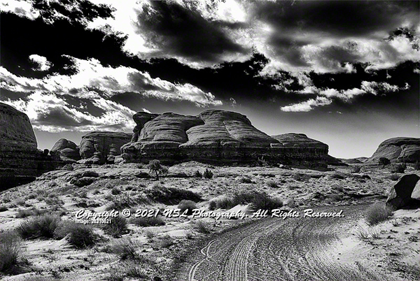 Wind eroded butte arising in Mystery Valley, Monument Valley Navajo Tribal Park, Kayenta, Arizona
