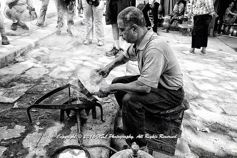 An artisan silver plating a copper bowl in the Fez medina