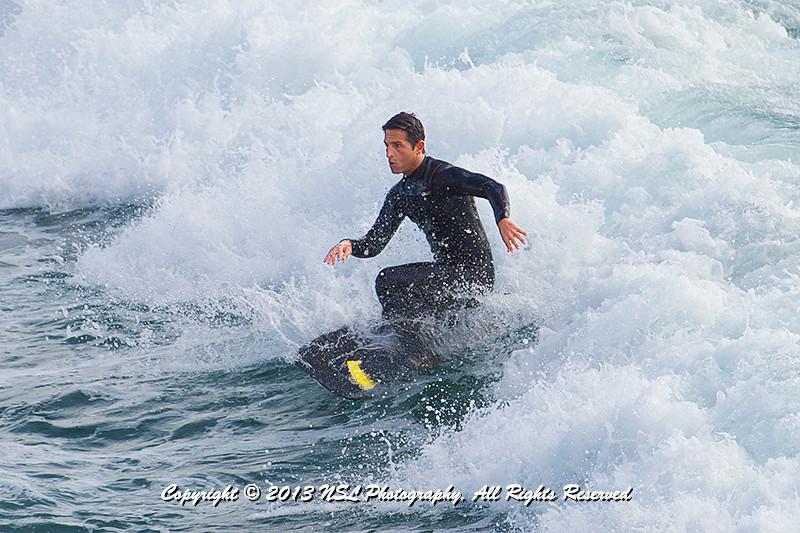 Surfing near the Hermosa Beach Pier