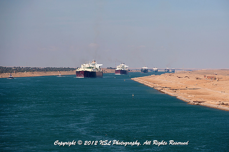 Traveling south on the Suez Canal, halfway between Great Bitter Lake, and the Canal's southern terminus, Port Suez