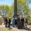 Members reading the inscription for the Robert Cushman monument ~ Guide, Peggy Baker, on far right ~