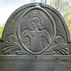 Detail of Portrait Stone: Note the shoulder-length hair drawn to one side only ~