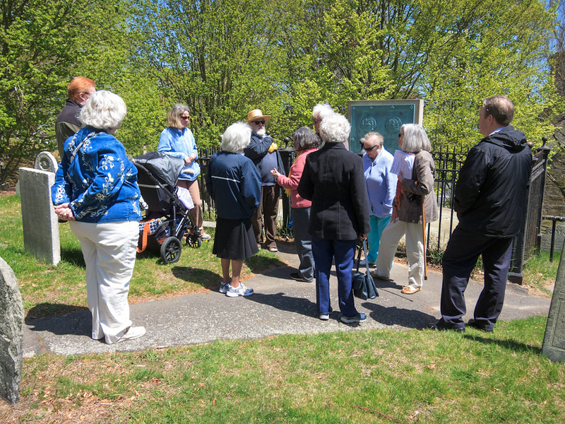 Members listening to guide, Peggy Baker, explaining about the site of the fort, gravestone styles, history of the Hill and plot layouts  ~