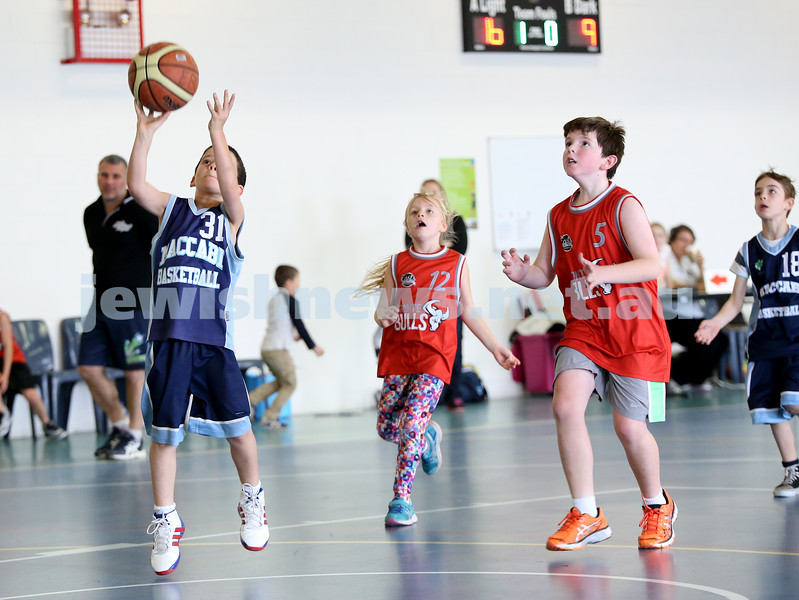 Maccabi vs Bronte Bulls U8 Basketball. Sam Greenberg shoots a basket.