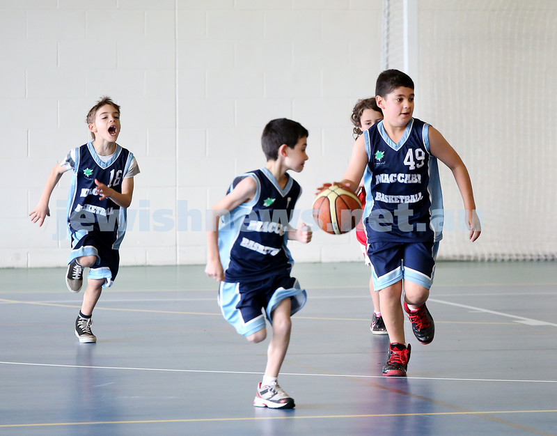 Maccabi vs Bronte Bulls U8 Basketball. Adiel Goldberg with the ball as Jed Miller & Coby Sher run alongside.