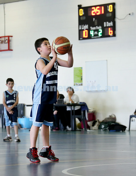 Maccabi vs Bronte Bulls U8 Basketball. Adiel Goldberg attempts a shot