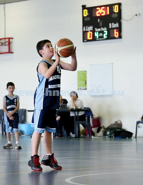 Maccabi vs Bronte Bulls U8 Basketball. Adiel Goldberg attempts a shot