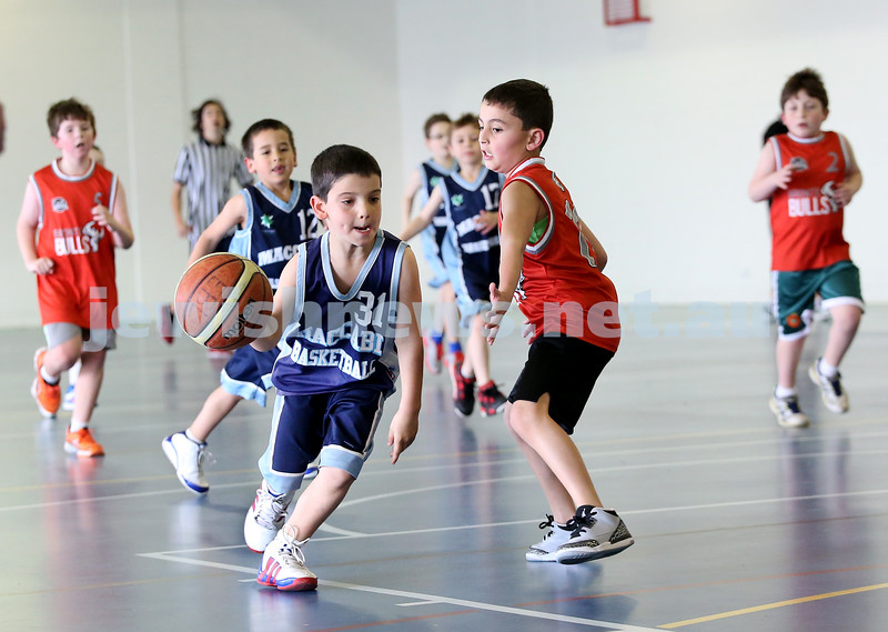 Maccabi vs Bronte Bulls U8 Basketball. Sam Greenberg with the ball, Dean Stein behind left.