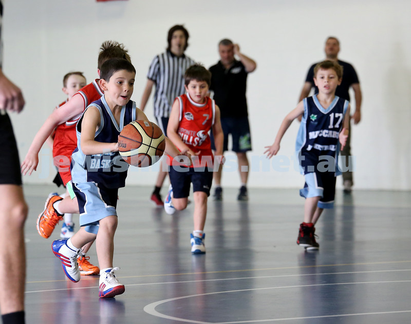 Maccabi vs Bronte Bulls U8 Basketball. Sam Greenberg with the ball and Jesse Geller chases (R)