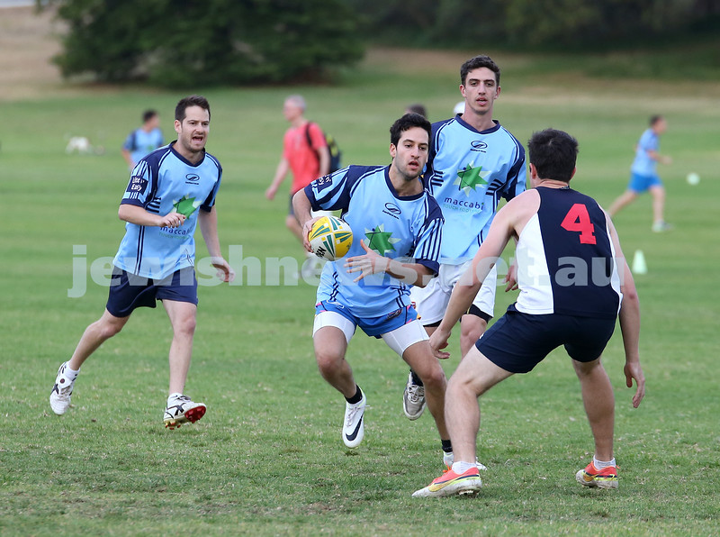 Touch Footy at Queens Park.  Maccabi Mataroa vs Kings Poker. Ben Kochan attempts to sidestep around a player, followed closely by Daniel Kochan (L) & Michael Roth (R).