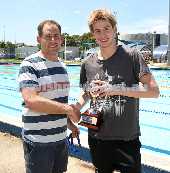 Jewish Swimming Championships held at Des Renford Pool in Maroubra. Mark Roseman presents Josh Blumberg with his trophy for winning the AJN 100m mens Open freestyle race.