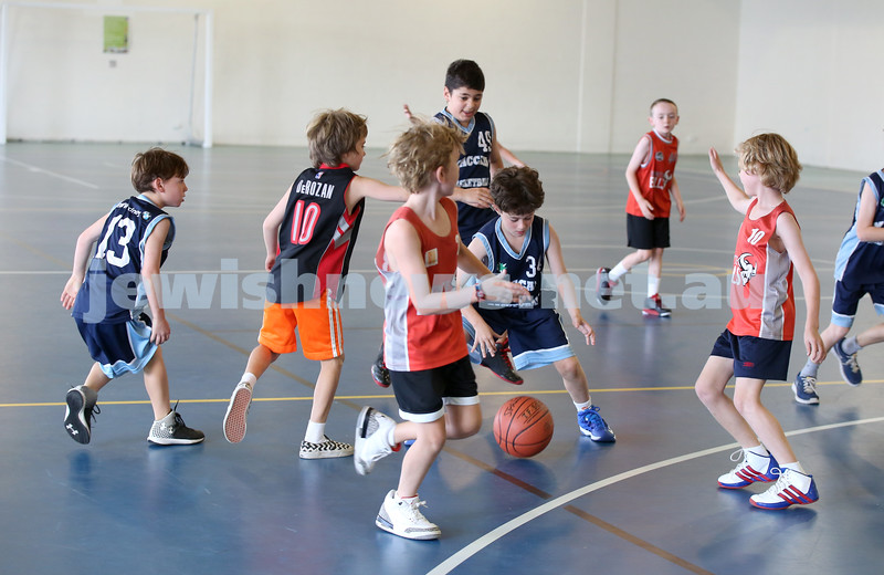 Maccabi Jets under 10 boys basketball team defeated  the Bronte Bulls 18-12 at Waverley. Tim Dunkel about to grab the ball.