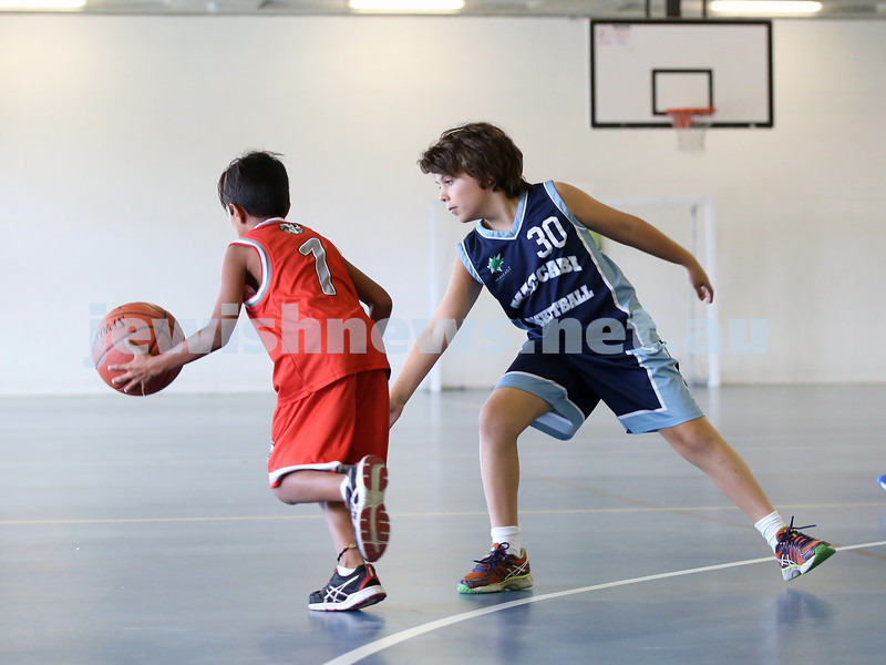 Maccabi Jets under 10 boys basketball team defeated  the Bronte Bulls 18-12 at Waverley. Toby Akres defends.