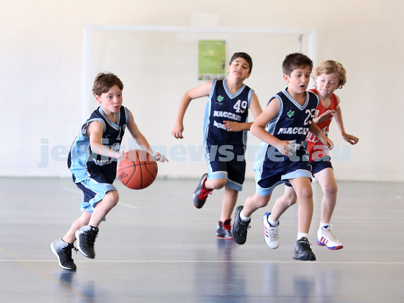 Maccabi Jets under 10 boys basketball team defeated  the Bronte Bulls 18-12 at Waverley. Joel Rusanow runs with the ball followed by Adiel Goldberg and Robbie Kaplan.