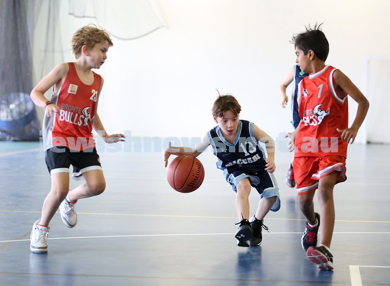 Maccabi Jets under 10 boys basketball team defeated  the Bronte Bulls 18-12 at Waverley. Joel Rusanow dribbles past 2 players.