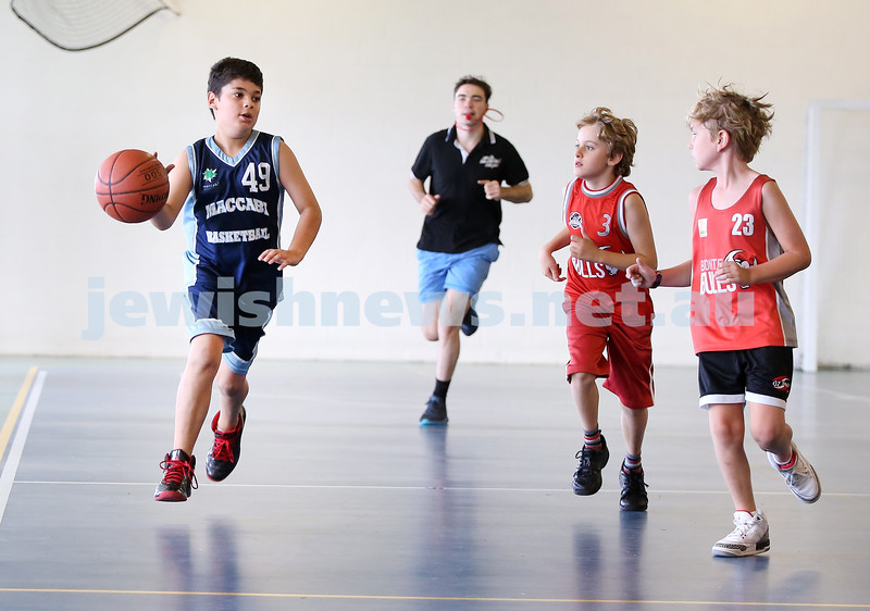 Maccabi Jets under 10 boys basketball team defeated  the Bronte Bulls 18-12 at Waverley. Adiel Goldberg powers down the court towards the basket.