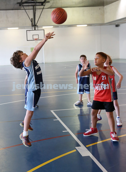 Maccabi Jets under 10 boys basketball team defeated  the Bronte Bulls 18-12 at Waverley. Toby Akres shoots a basket.