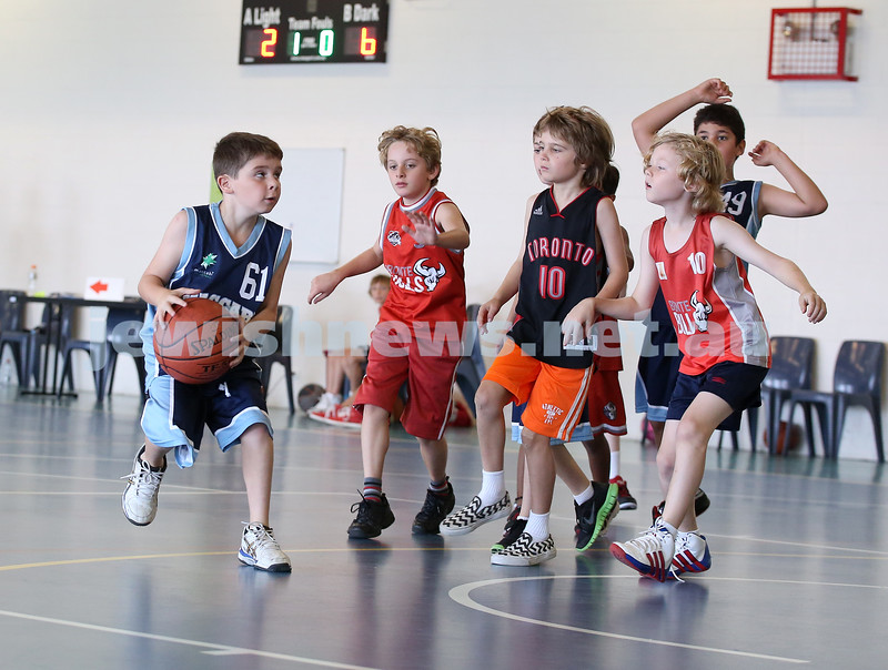 Maccabi Jets under 10 boys basketball team defeated  the Bronte Bulls 18-12 at Waverley. Noah Aizenstros about to take a shot at basket.