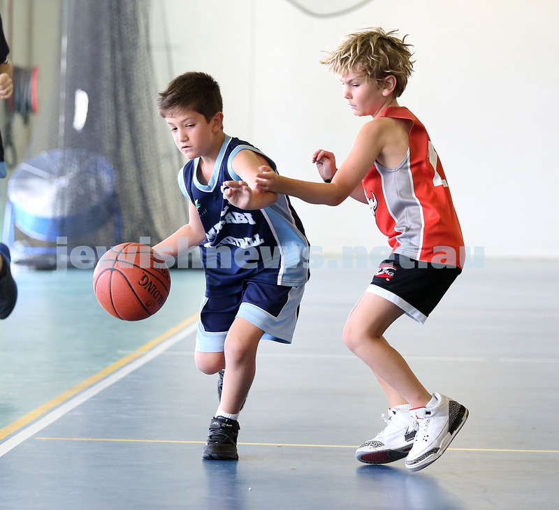 Maccabi Jets under 10 boys basketball team defeated  the Bronte Bulls 18-12 at Waverley. Robbie Kaplan races past a Bulls player.