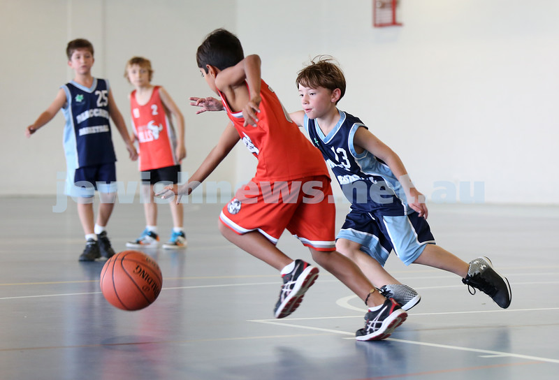 Maccabi Jets under 10 boys basketball team defeated  the Bronte Bulls 18-12 at Waverley. Joel Rusanow blocks an opponent.