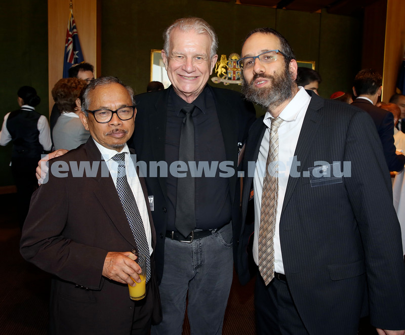 Chanukah Party at NSW State Parliament House. Amin Hady, Rev Bill Crews, Rabbi Zalman Kastel. Pic Noel Kessel