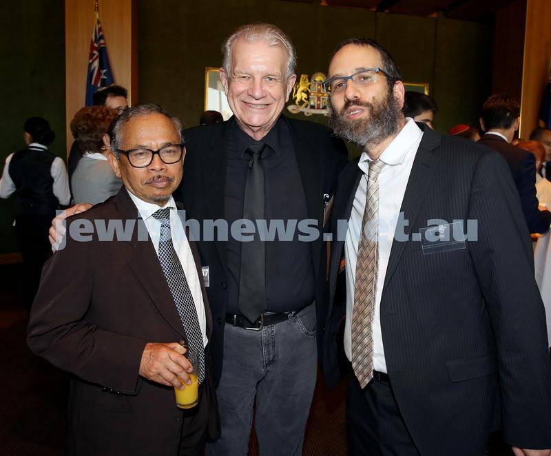 Chanukah Party at NSW State Parliament House. Amin Hady, Rev Bill Crews, Rabbi Zalman Kastel. Pic Noel Kessel