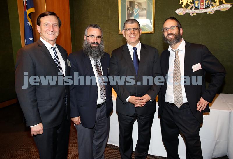 Chanukah Party at NSW State Parliament House. MP Ron Honeig, Rabbi Dovid Slavin, MP John Ajaka, Rabbi Zalman Kastel.