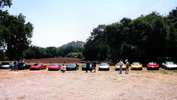 Our caravan pulls off road and stops for lunch at Boccalis in Ojai.  From left-to-right, Sam's supercharged NSX, Craig's NSX, Marc (SpeedDemon)'s twin turbo NSX-T, Chris' NSX, Eric's NSX, Randy (FuryNSX)'s NSX-T, Calvin (CChung)'s NSX-T, John (Anytime)'s NSX-T, Steve (NSX1)'s NSX-T, my (akira3d)'s NSX-T, and Walter (W)'s NSX (I cropped out Ilya's NSX from the left side of the shot because it was parked behind some unsightly porta-potties).