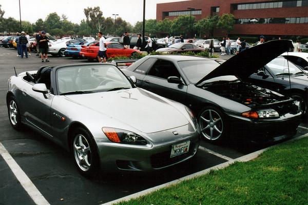 NSX's younger brother and an older R32 Nissan Skyline GT-R get ready for the drive.  Though Nissan has considerably refined the GT-R's design over the past decade, even the most recent model (R34) fails to excite me.  I'd much rather have a small sporty roadster like Honda's S2000 than a high-performance sedan-ish coupe.