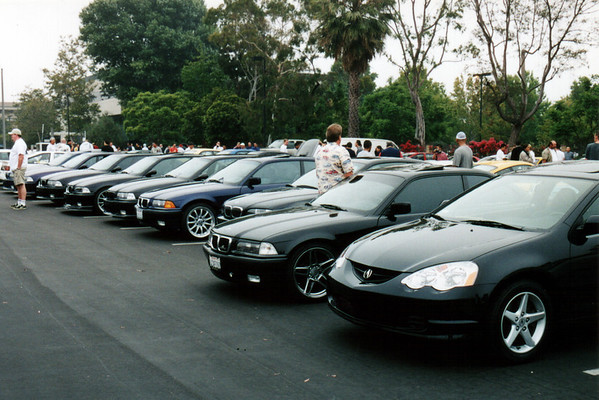Many BMW sedans and coupes (including M3s) congregate before the drive.  A brand new 2002 Acura RSX Type S (the Integra's replacement) squeezes into the foreground, a design that I still haven't warmed up to.  I hope that the next-generation NSX adopts nothing from this coupe's design...not the Acura family grill, not the creased hood, and especially not those damned headlights.