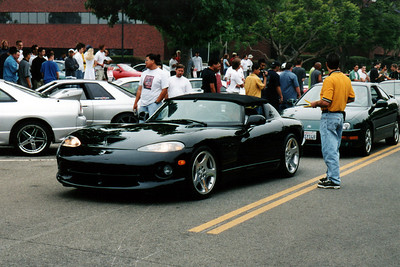 From dainty speedsters to hulking American muscle, a wide range of convertible sports cars are well represented at the meet.  This Dodge Viper, the first I've ever seen with its soft-top up, pulls in ahead of an Acura Integra.  Though this monstrous snake is powered by an impressively powerful engine, I'd never consider owning one.