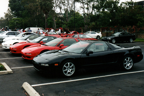 After meeting with three local NSXers just a few blocks away, we arrive together at the so-called 'exotic car gathering'.  Though only a few exotics catch my eye upon arriving, I am immediately overwhelmed by the sheer size and scope of the event.  Sports cars of all makes and models are well represented, like models often parked together (as our group chose to do in the above picture).  I feel as though I have stepped into the car selection screen of Gran Turismo.