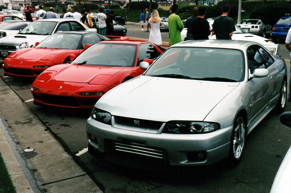Three of Japan's finest sports cars gather side-by-side before going on the drive.  Though the R33 Nissan Skyline GT-R cannot compete with the NSX's visual beauty, GT-R's have been known to outperform NSXs on the track.  Though hardly an exotic, the Skyline is even more rare than the NSX in North America...because Nissan has yet to officially ship a left-hand drive model to our continent (all GT-R's at this event are right-hand drive imports purchased through Torrance-based MotoRex).