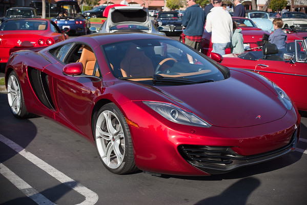 "The lady who owns this red McLaren explains that ""Volcanic"" denotes the metallic variation of the color (the MP4-12C comes in a basic clearcoat variations of the orange and red on display here today)"