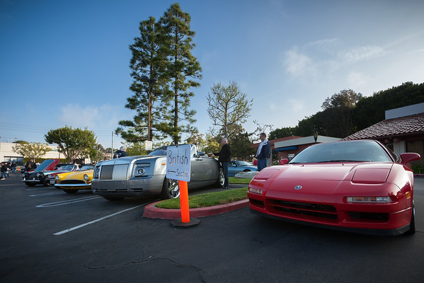 The organizer directs me to park in the red zone after I balked at squeezing in between the Porsches