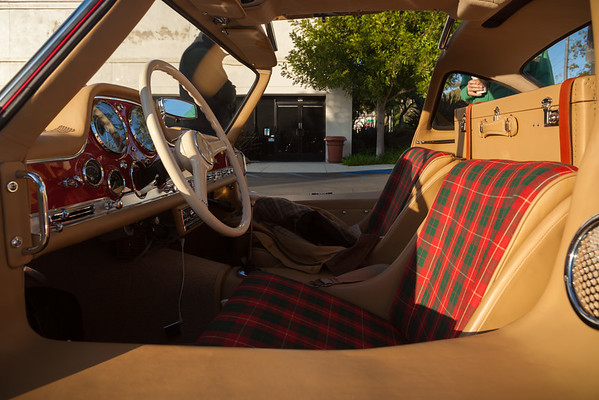 This is the first time I have seen one with a plaid interior...and it works.  That said, I still prefer the silver with the red interior