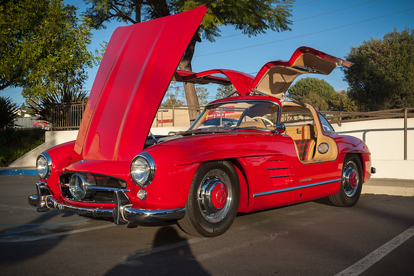 The Mercedes 300 SL is still my favorite of the classics..and, by moving his car into the one patch of direct sunlight, its owner essentially parked his car in the spotlight