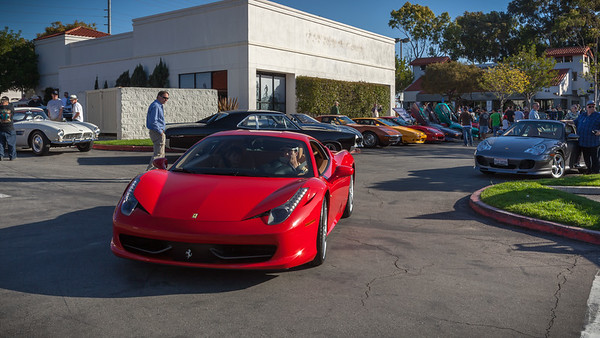 Ferrari 458 Italia circles the lot trying to find a space