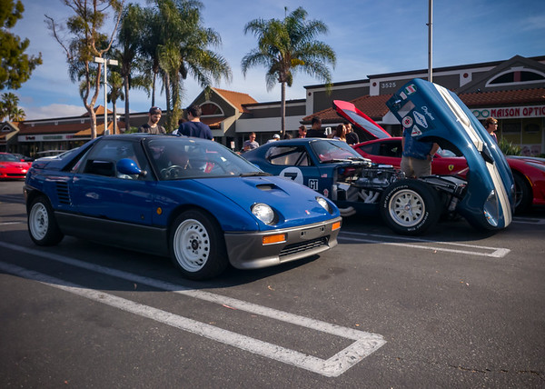 AZ1 Autozam prepares to depart.  Keep in mind that the Shelby Daytona parked next to her isn't exactly a large vehicle (it's nearly a foot SHORTER than my NSX)...and look how much empty space surrounds her car.