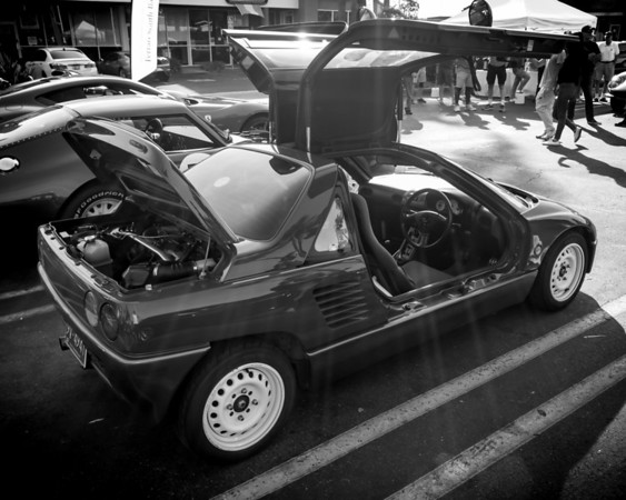 AZ1 Autozam in black and white.  A couple of other interesting details about this car...not a whole lot of sound deadening material between the cockpit and the engine.  The