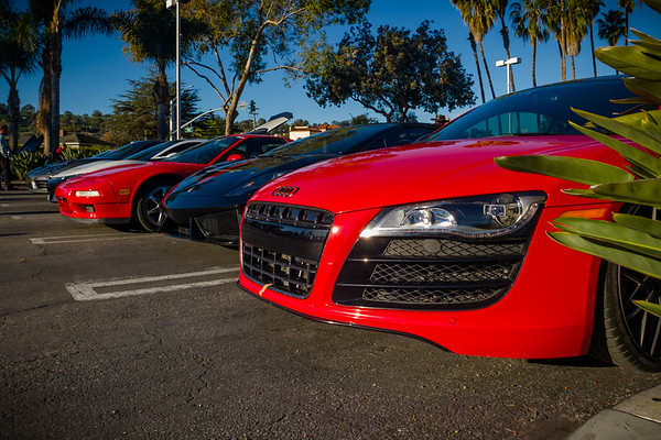 An Audi R8 V10 parks with a bandaged front arrives and parks in the end spot