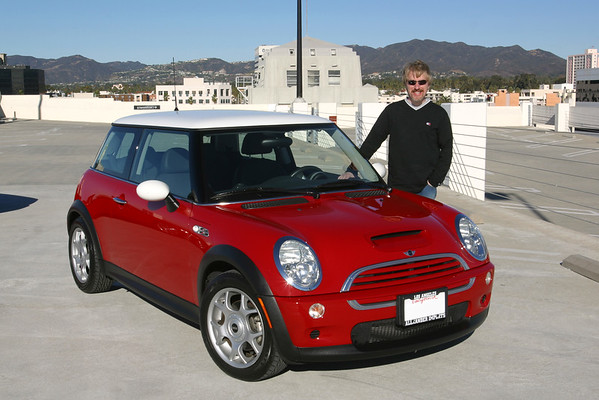 Toby poses with his Mini, recently acquired from a departing team member