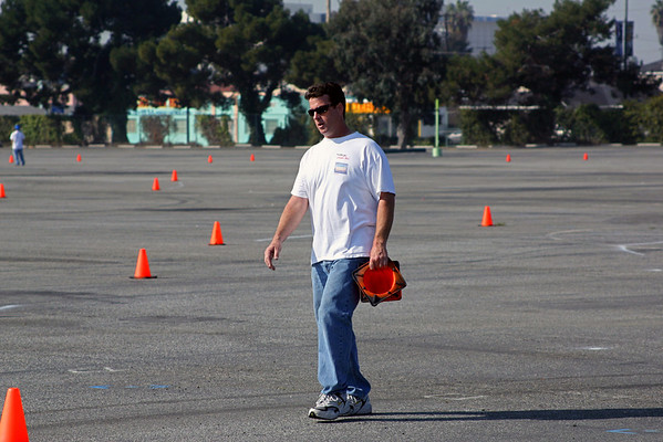 John moves some cones hoping to clear up some confusion on the course