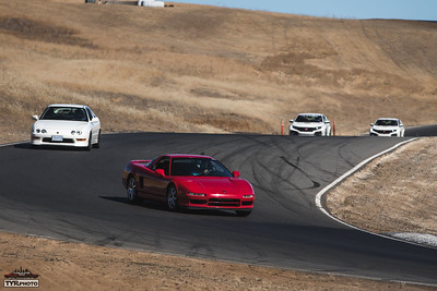 Thanks to this HPDE being a joint event with Type R Expo, the cars I am on track with are a bit more varied than I am used to.  As the turn 11 corner worker comes into view, I see the black flag point in my direction...looks like my out lap will also be an in lap. (Photo by Trevor Ryan)