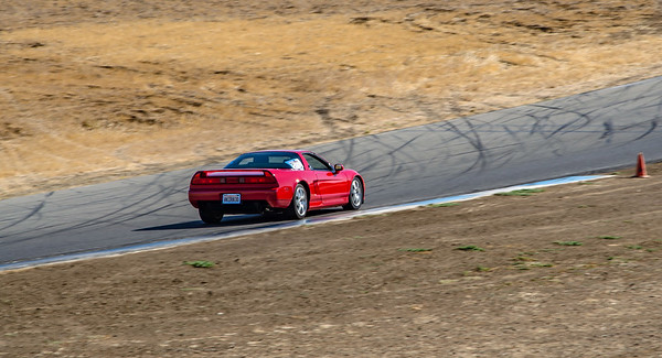 With nervous excitement, I begin my first session on Thunderhill East...and, despite being uber cautious, I manage to put two tires off on the outside of Turn 3 during the out lap!   (Photo by AJ Aviles)