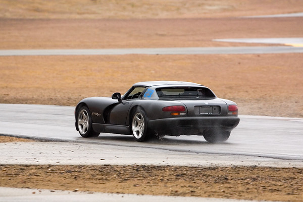 The Viper is kicking up water while accelerating down the front straight