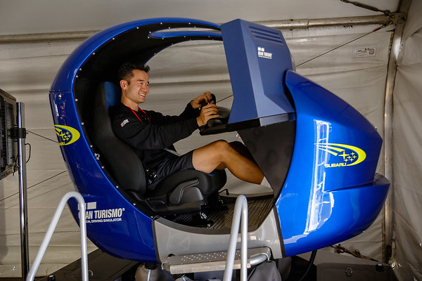 Inside the Subaru tent, Pete tries out the GT Concept motion simulator