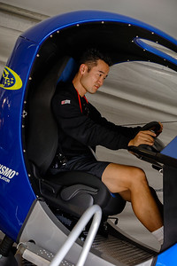Either he is incredibly focused, or seriously upset that this is NOT Gran Turismo 4
